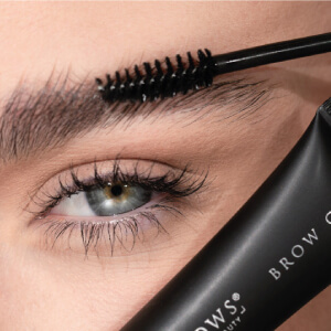 Woman using HD Brows products on her brows